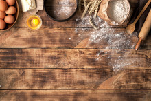 Flour With Ingredients For Bakery Products On Wooden Background