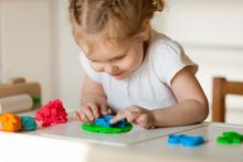 Pretty Little Girl Sculpts From Plasticine, Indoor