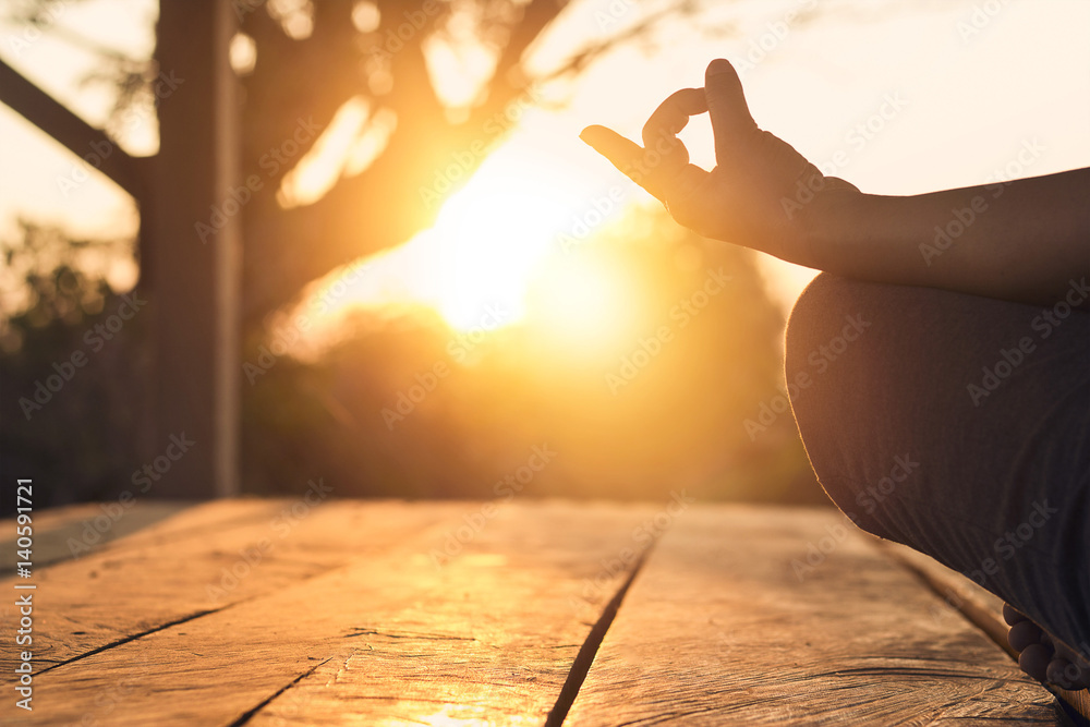 Fototapety, obrazy: Hand of woman practicing meditation yoga on the nature at sunset