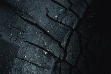 Black Carbon Charcoal Dry Crack Old Tire Dark Color For Background.
