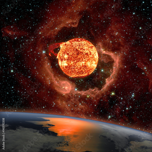 Sunrise over the planet Earth. The Sun in eruption appears on the RCW 79 in the southern Milky Way in the Centaurus constellation in background. Elements of this image furnished by NASA.