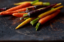 Fresh Multicolored Carrots On A Dark Background