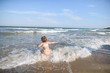 Girl Playing in Sea Waves