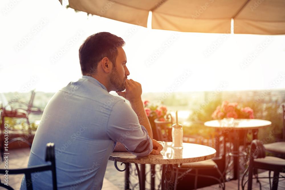 Fototapeta Sad single man waiting for his date