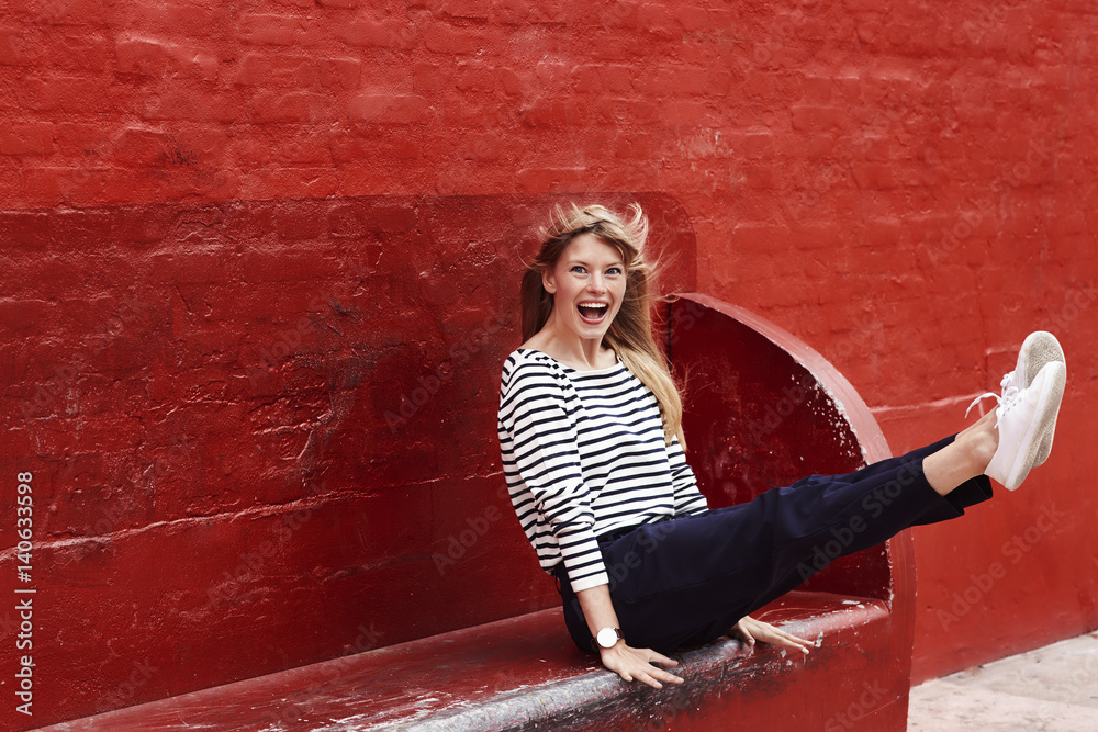 Fototapety, obrazy: Ecstatic blond woman on red bench, portrait