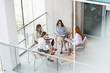 High angle view of businesswomen discussing in office