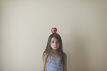 Girl With Red Apple On Head