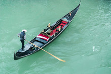 High Angle View Of Gondolier Oaring While Standing On Gondola