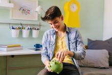 Teenage Boy Saving Money For University