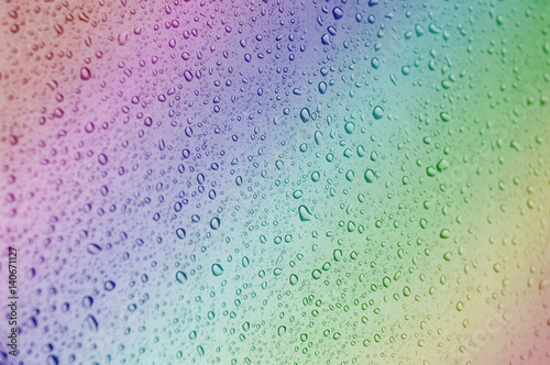 Naklejka na szybę Close up to rainbow color water drops on glass with selective focus