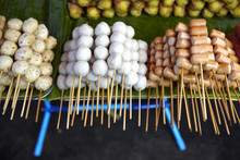 Skewers Of Streetfood On A Table In Thailand.