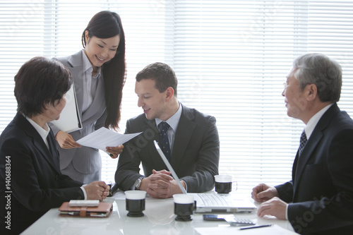 Businessmen and Businesswomen In a Meeting