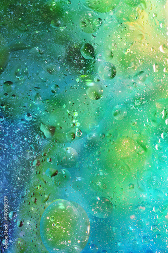 Abstract Background with Bubbles in Green and Blue