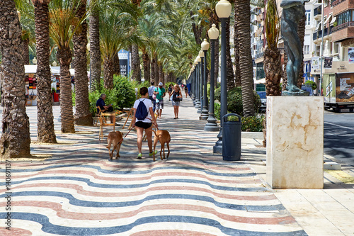 Alicante, Spain - June 30, 2016: The promenade Explanada of Spain in Alicante is paved with 6.5 million marble floor tiles creating a wavy form and is one of the most lovely promenades in Spain.