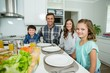 Portrait of smiling family having lunch together on dining table