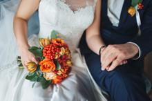 Bride With Groom And Wedding Orange Bouquet