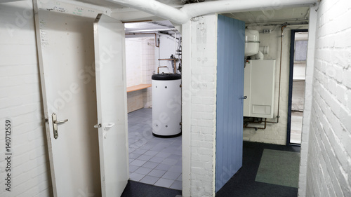 Fotografia  Basement, cellar, heating unit and garage in an old house, corridor, hallway