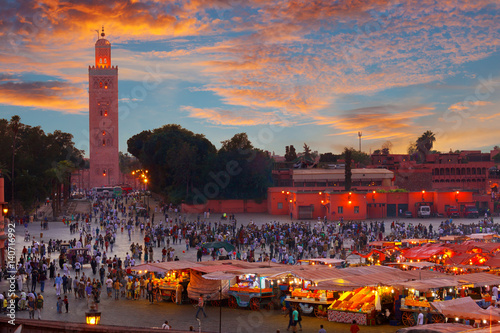 Photo Stands Morocco Famous Jemaa el Fna square crowded at dusk. Marrakesh, Morocco