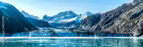 Glaciers Panoramic view in Glacier Bay from cruise ship cruising towards Johns Hopkins Glacier in summer in Alaska, USA. Banner panorama crop.