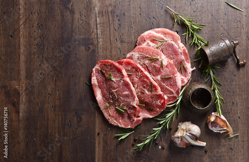 Fotografie, Obraz  Pork steak with rosemary, garlic and pepper , free space for your text