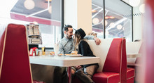 Couple In Love Cuddling In Diner Restaurant