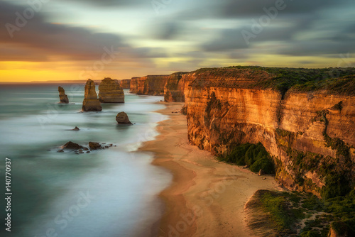 Obraz na plátně  Sunset over The Twelve Apostles  in Victoria, Australia, near Port Campbell