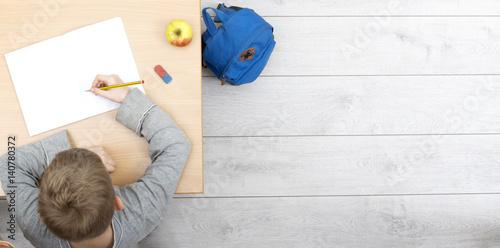 Fotografie, Obraz  young kid at school behind desk