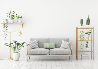 Urban jungle style livingroom with gray sofa, golden lamp and plants in pots on white wall background. 3d rendering.