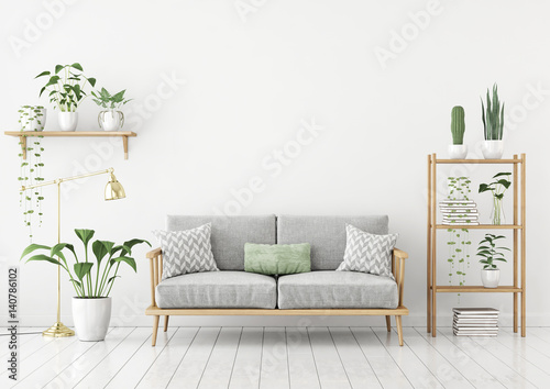 Fotografie, Obraz  Urban jungle style livingroom with gray sofa, golden lamp and plants in pots on white wall background