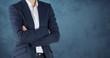 Businesswoman Torso against neutral dark blue background