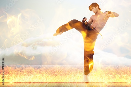 Deurstickers Vechtsport Composite image of martial arts fighter over fire flames