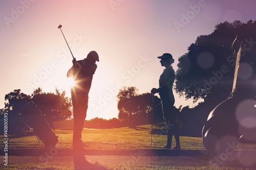 Deurstickers Golf Composite image of golfing couple playing together