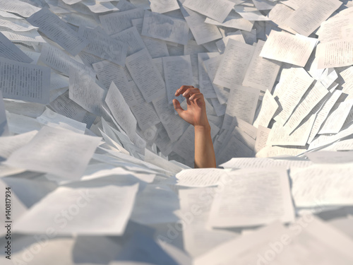 hand drowning in paper sheets Fototapeta