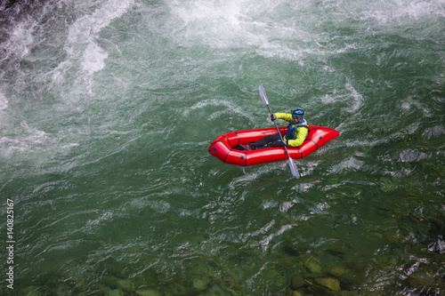 Adam Palmer, mountain athlete, navigates a white water section of the Chehalis River on a packraft.