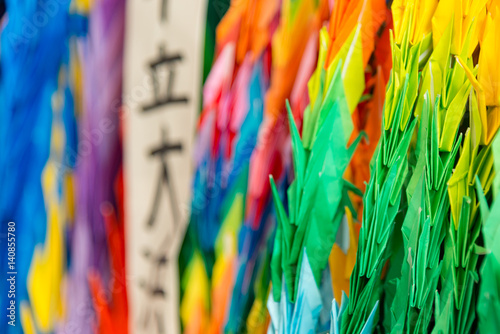 Fotobehang Paradijsvogel Thousand colorful origami paper cranes with a shallow depth of field