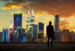 The silhouette portrait.of businessman on the roof to see the scenery. Concept of vision of the future .