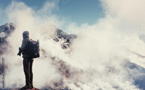 Fotobehang Spoorlijn Photographer on cliff. Nature takes photos with mirror camera peak of rock.