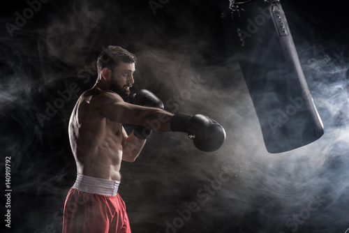 Photo  Young boxer punching