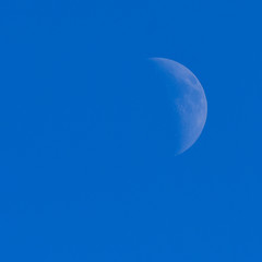 Daytime view of moon phase waning crescent.