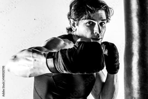 Photo  Muscular kickbox fighter