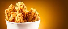 Fried Chicken Wings And Legs. Bucket Full Of Crispy Kentucky Fried Chicken