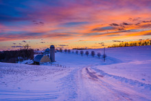 Sunset Over A Snow Covered Road And A Farm In A Rural Area Of York County, Pennsylvania.
