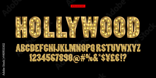 Fototapeta Hollywood. Color Golden alphabet with show lamps.