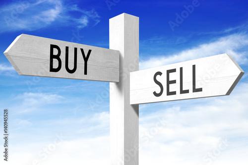 Fotografía  Sell, buy - wooden signpost