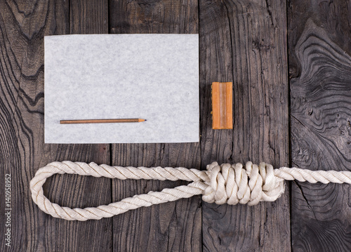 Fotografie, Tablou  A rope for hanging and a suicide note on an old wooden table,Loop lynch, soap