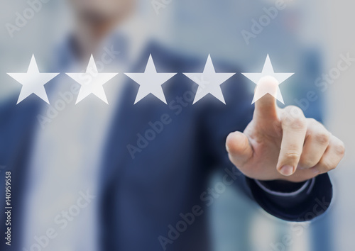 Five stars  5  rating with a businessman touching screen