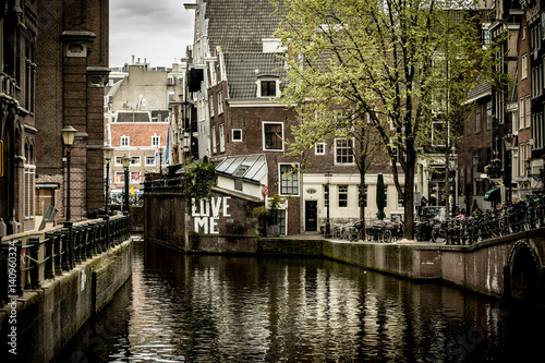 Houses along a canal in Amsterdam Canvas Print