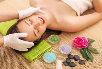 Obraz na płótnie Canvas Close-up of a young woman getting spa treatment at beauty salon. spa face massage. facial beauty treatment. spa salon.