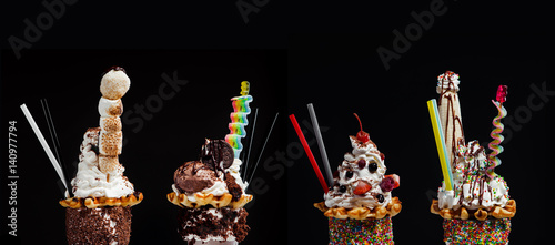 Four freak and crazy giant milkshakes against black background