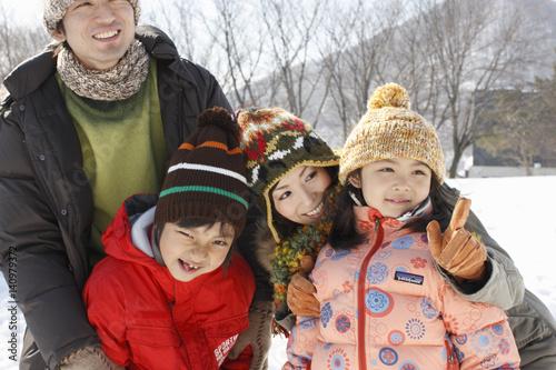 Spoed Fotobehang Carnaval Family in winter